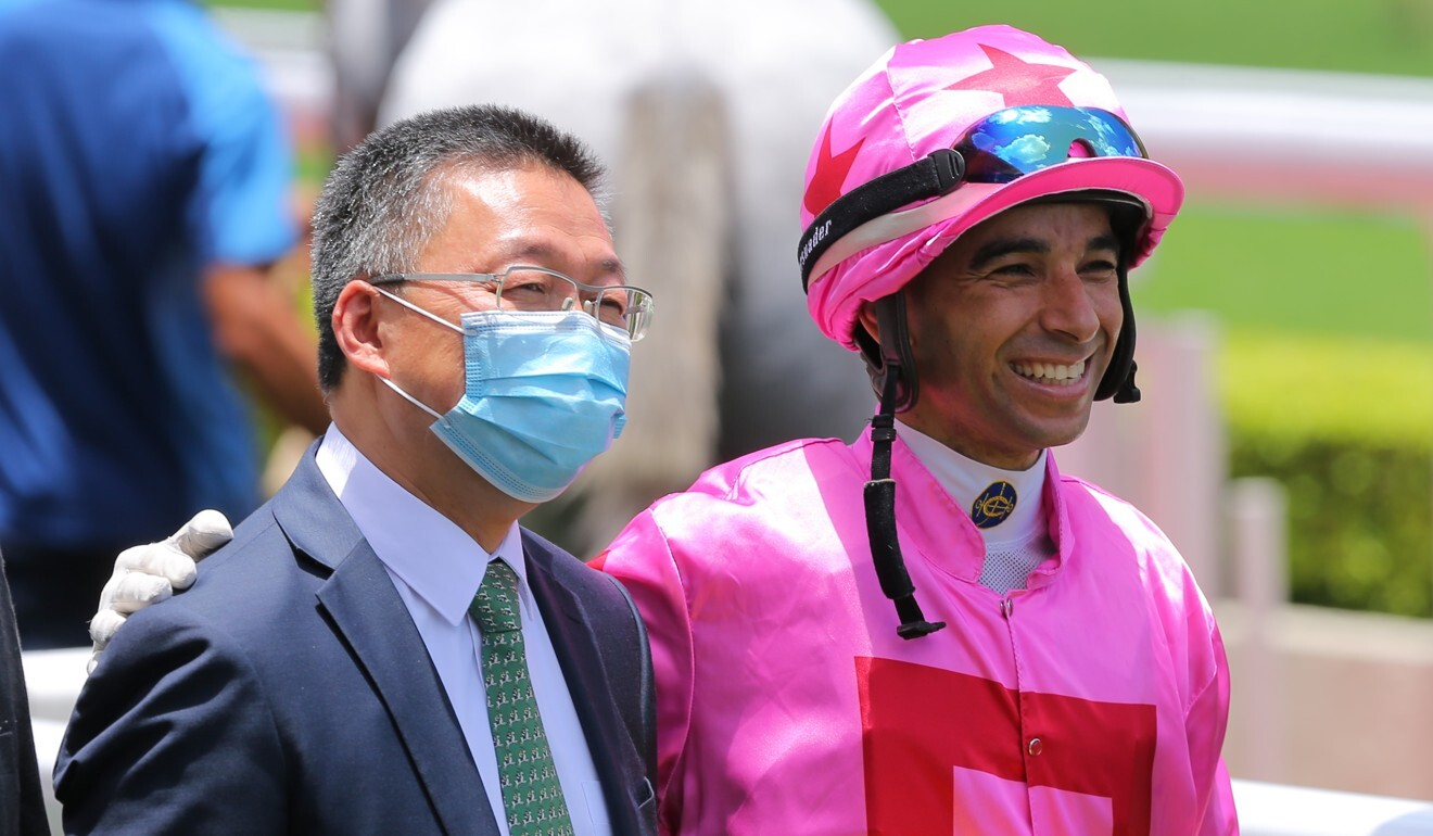 Trainer Francis Lui and jockey Joao Moreira celebrate Chancheng Prince's victory.