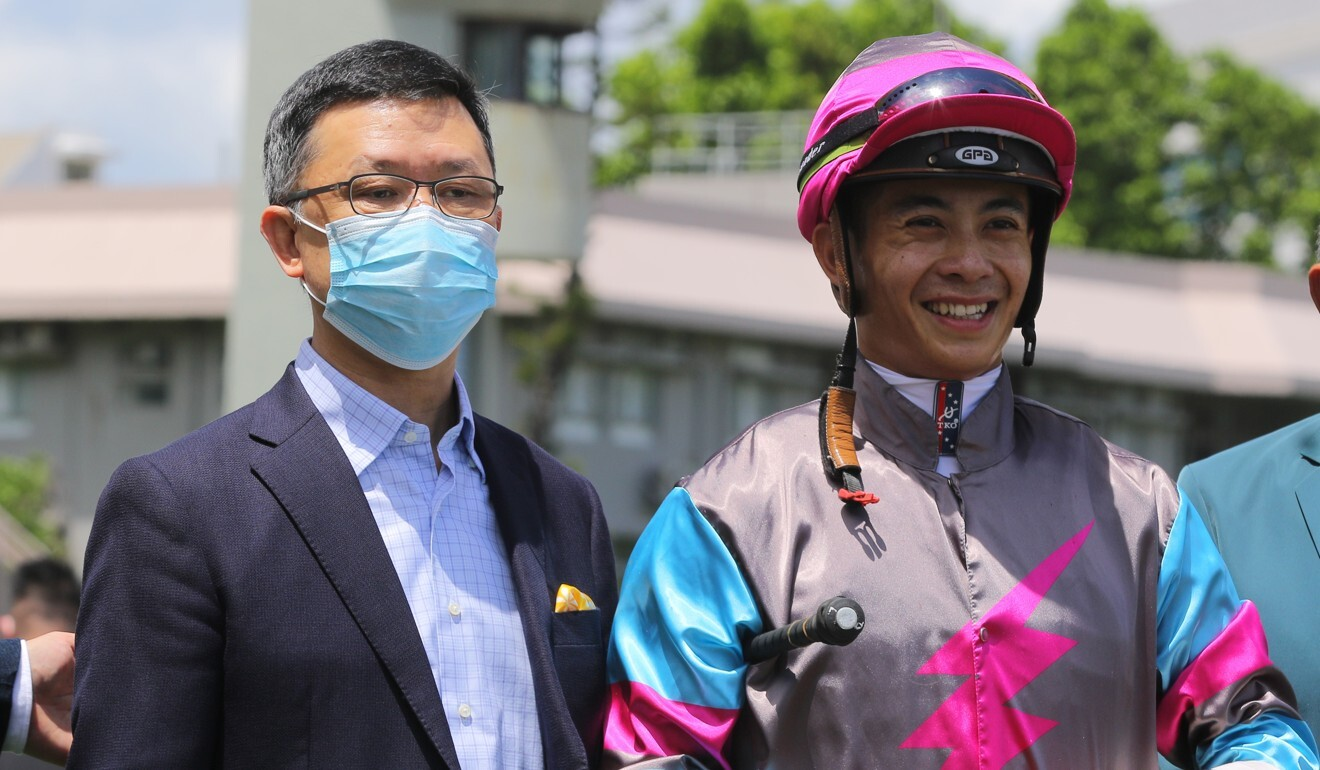 Trainer Peter Ho and jockey Derek Leung celebrate Hay Run's victory.