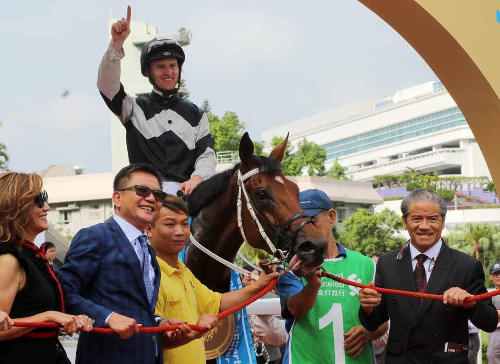Wong Leung (left) and the rest of the Exultant team celebrate his win in the 2019 Champions & Chater Cup.