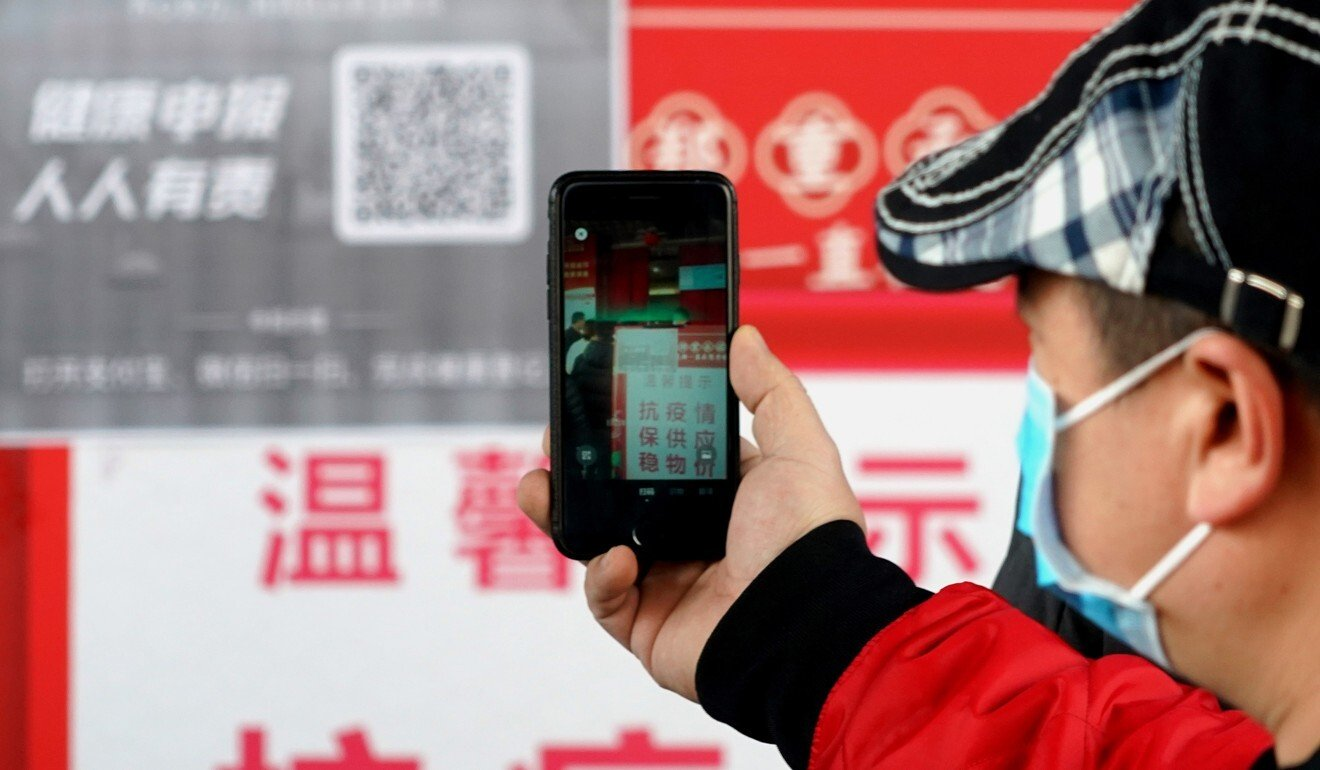A resident scans a QR health code in February at the entrance of a supermarket in Zhengzhou, a city in central China's Henan province. Photo: Xinhua
