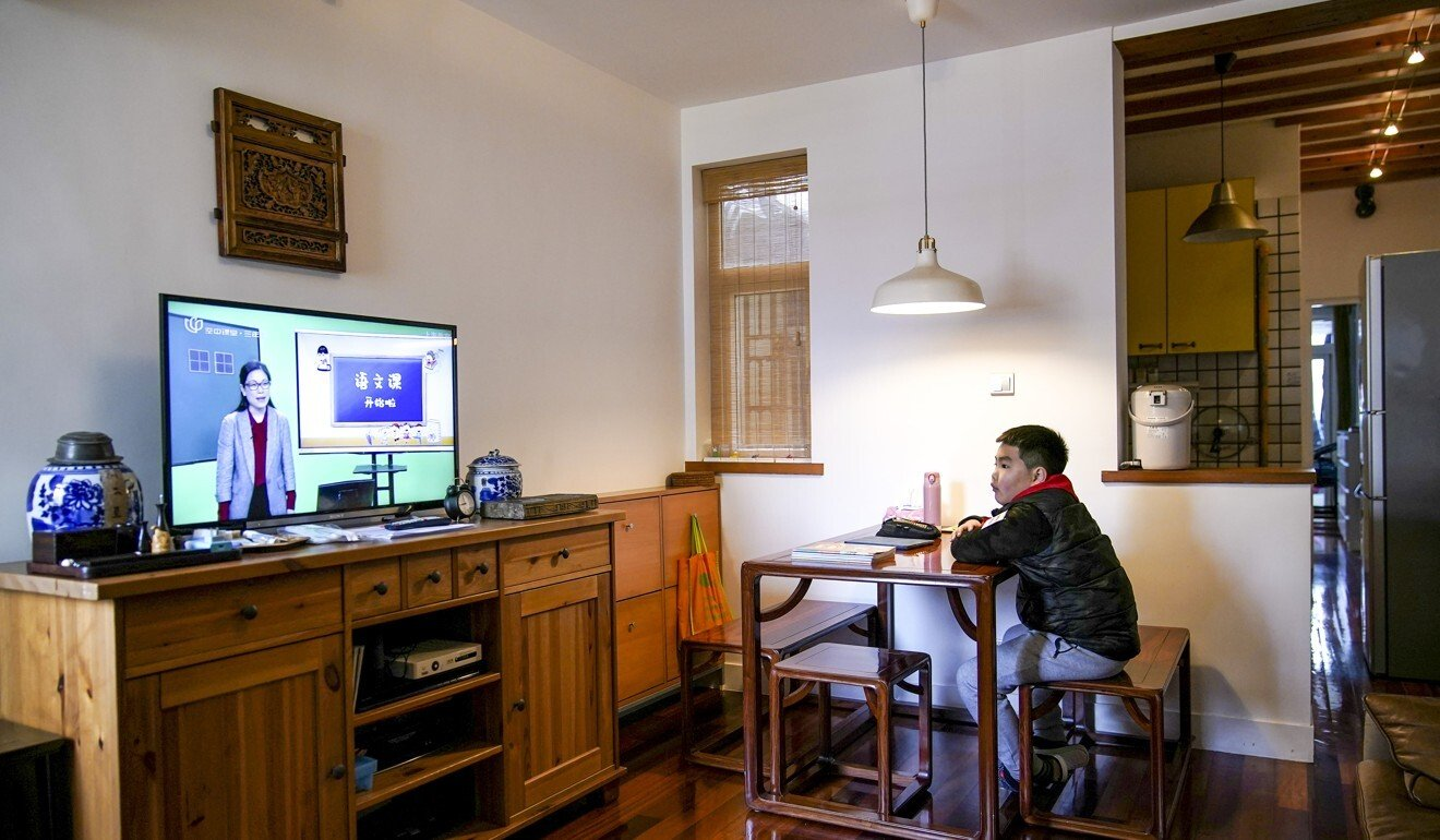 Shanghai primary school student Sha Jie, 10, attends an online Chinese class as he sits at home on March 3 during the novel coronavirus outbreak. Photo: Reuters