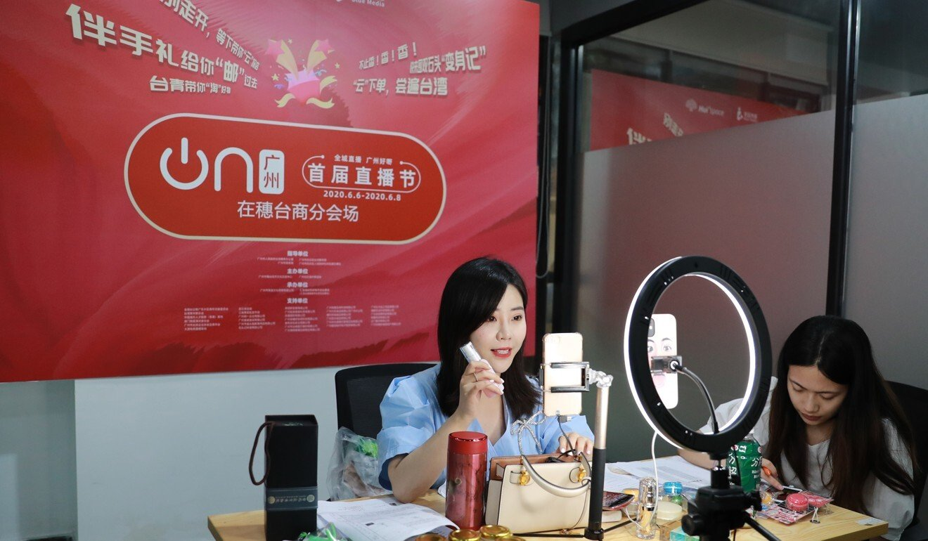 A live streamer presents products during a June streaming session in Guangzhou. Photo: Xinhua