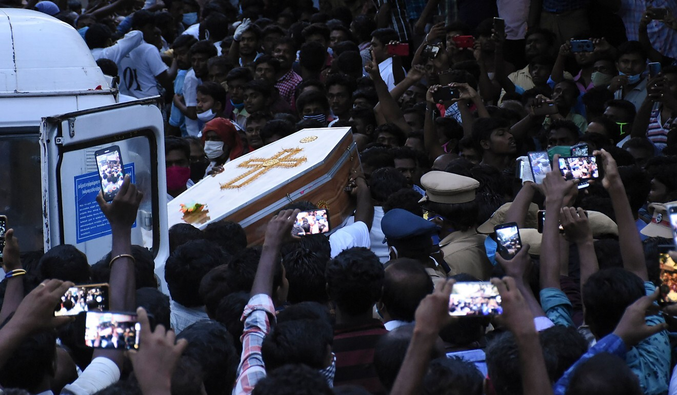 Residents gather as they carry the coffin of J Jayaraj and son Bennicks Immanuel on June 26 in Sathankulam, Tamil Nadu state. Photo: AFP
