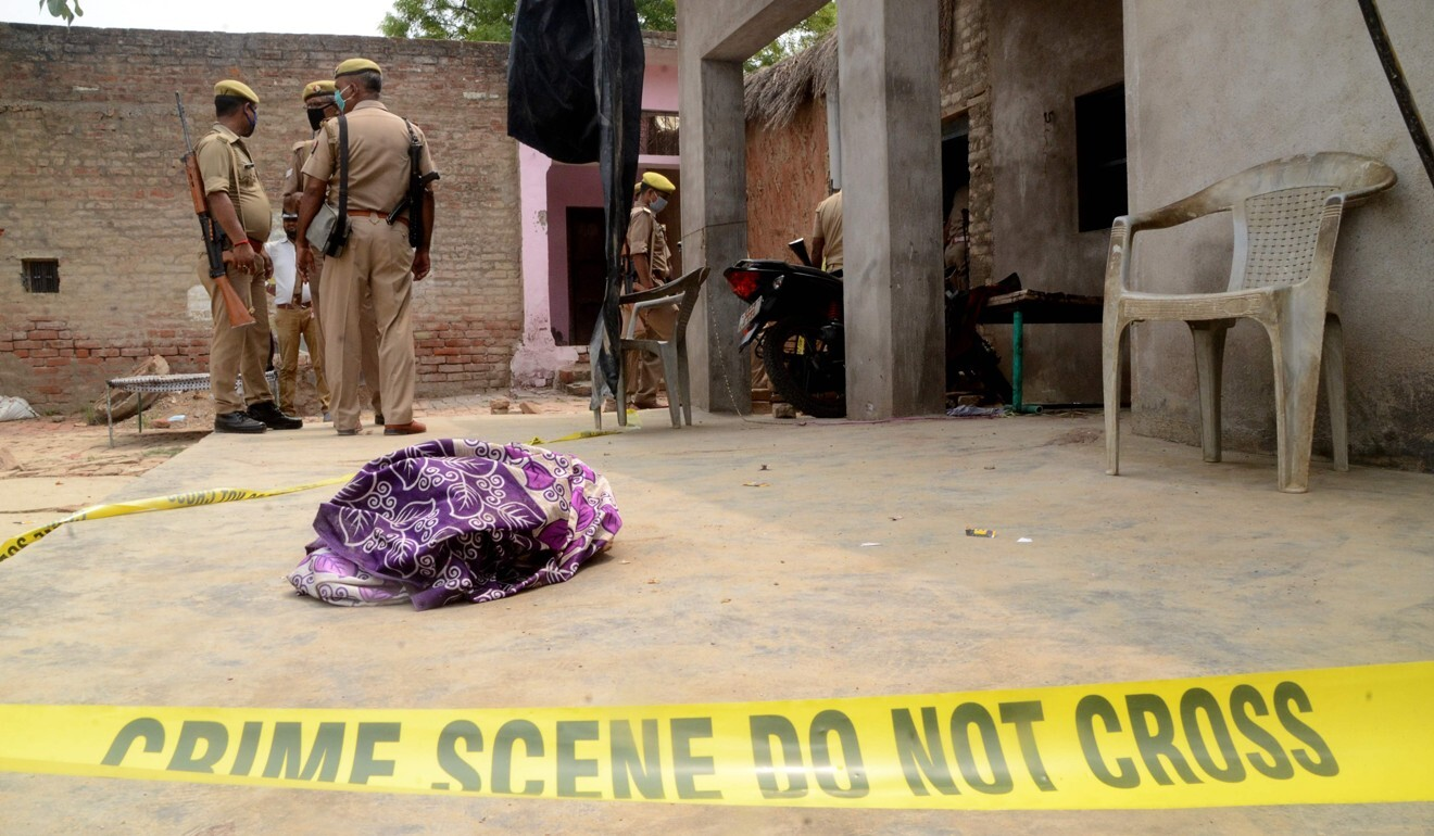 Police stand guard at the scene of a crime in Uttar Pradesh state. Photo: AFP