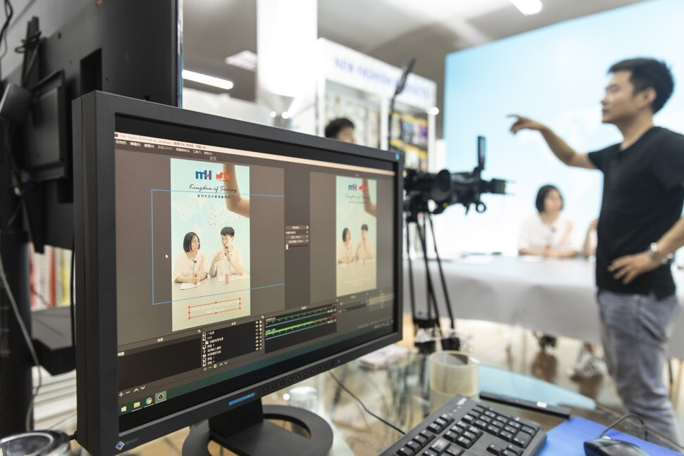 Employees are shown on a screen as a crew prepares a rehearsal for a live-streaming session for the Canton Fair inside a showroom at Ningbo MH Industry Co in Ningbo, a city in eastern China's Zhejiang province, on June 10. Photo: Bloomberg