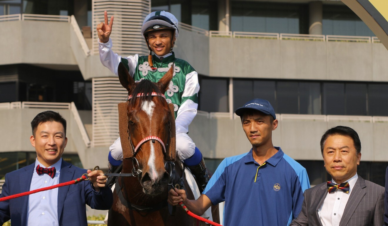 Ricky (first from right) and Eric Yiu (first from left) celebrate a winner at Sha Tin earlier this season.