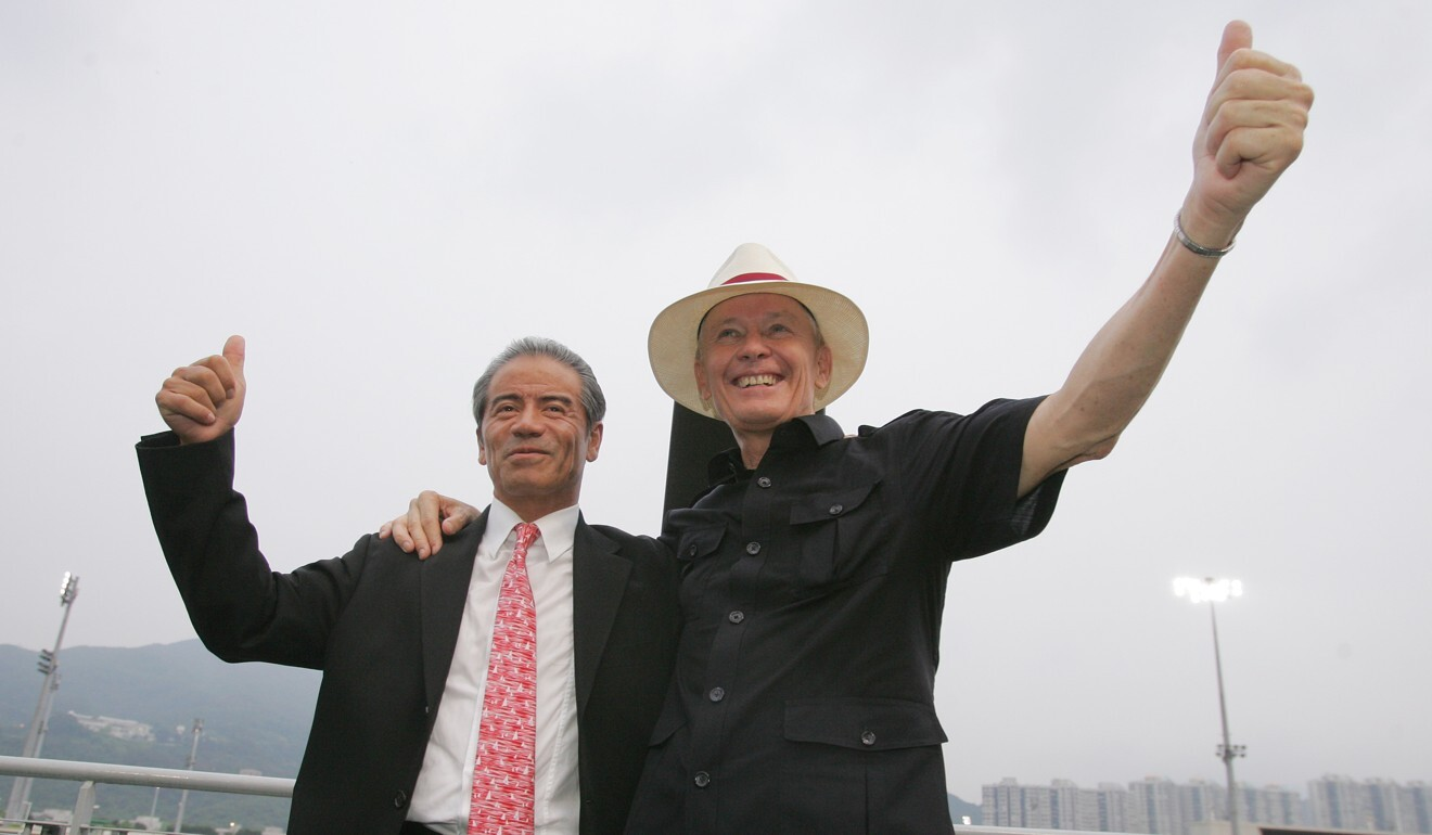 Tony Cruz (left) and John Moore play up to the press at Sha Tin in 2011.