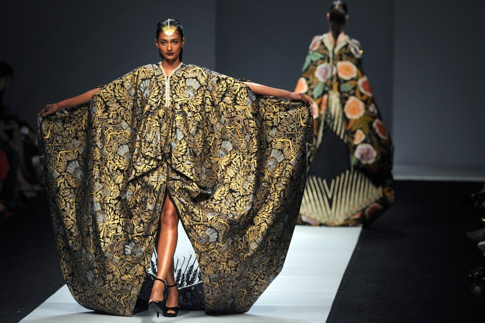 Models present creations made from Indonesian batik textiles during Jakarta Fashion Week in 2014. File photo: AFP