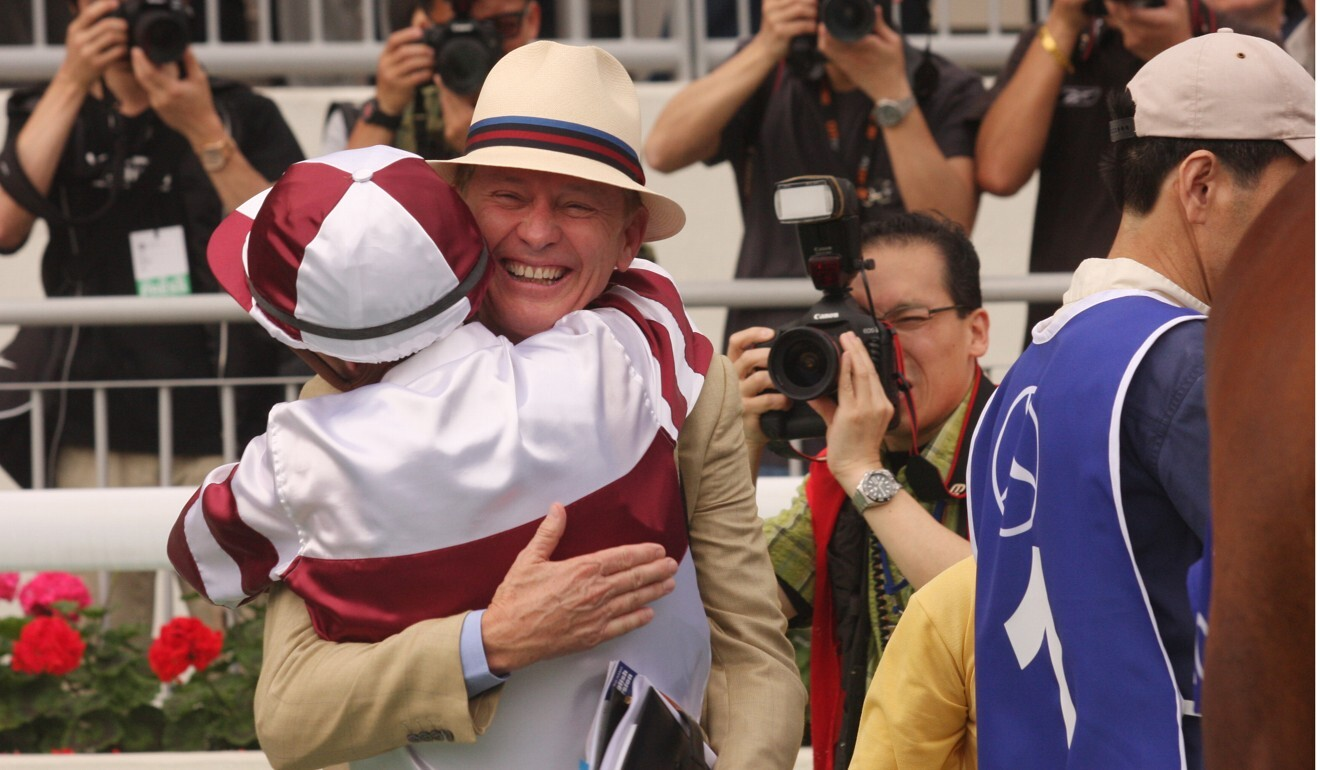 John Moore hugs Darren Beadman after winning the 2009 Hong Kong Derby with Collection. Photo: Kenneth Chan