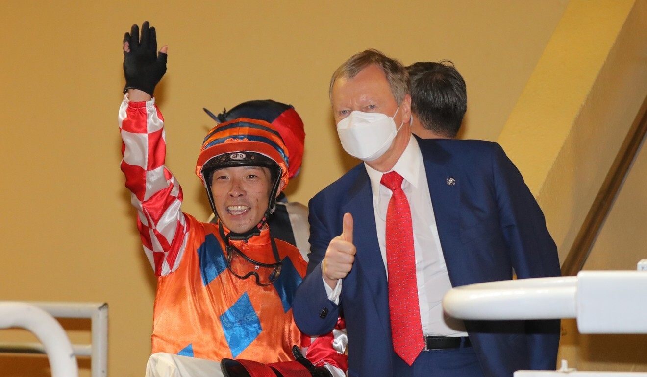 Jockey Ben So with Jockey Club chief executive Winfried Engelbrecht-Bresges on Wednesday night.