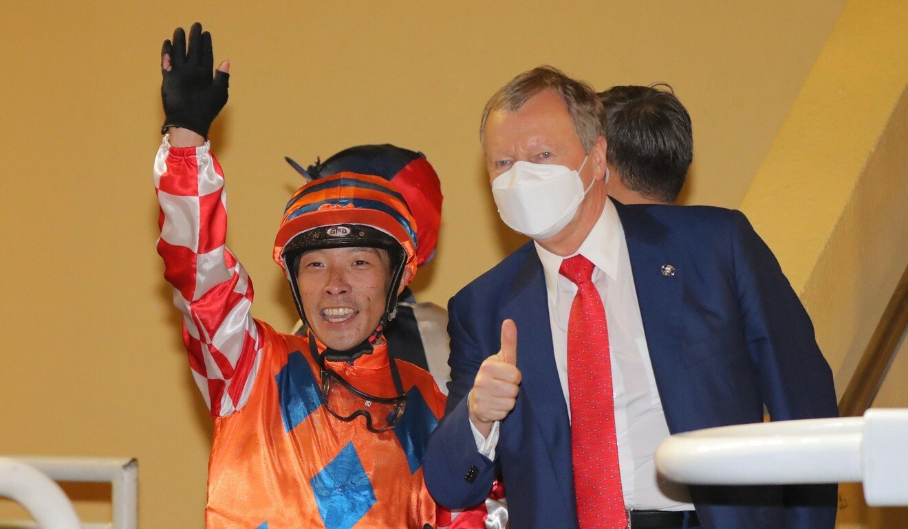Jockey Ben So and Winfried Engelbrecht-Bresges at Happy Valley on Wednesday night.