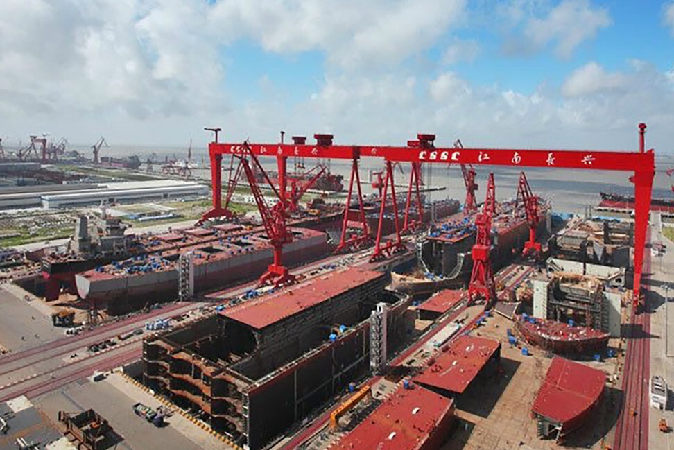 The new Type 002 aircraft carrier – to be the Chinese navy's third – has entered key assembly process in a dry dock in Jiangnan Shipyard outside Shanghai. Photo: Weibo