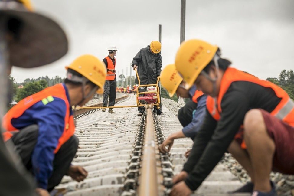 Workers from the China Railway No 2 Engineering Group build the China-Laos Railway in the northern suburb of Vientiane, Laos, last month. The railway, expected to open by the end of 2021, is part of the Belt and Road Initiative and would convert Laos from a landlocked country to a land-linked hub. Photo: Xinhua