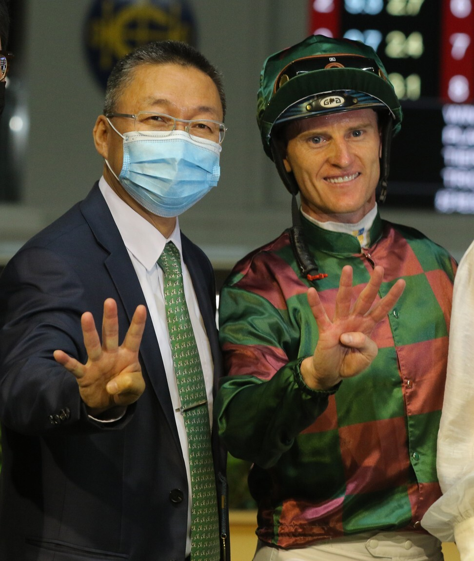 Trainer Francis Lui and jockey Zac Purton celebrate their four-timer in June.