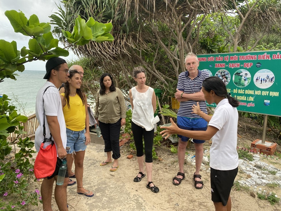 Huong Pham (right) explains sea turtle nesting to the tour group. Photo: Patrick Scott