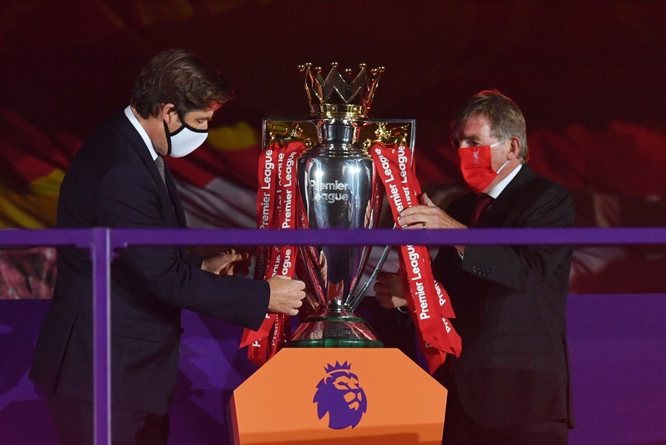 Premier League CEO Richard Masters and Liverpool legend Kenny Dalglish prepare the Premier League trophy for presentation, but Masters may have bigger concerns. Photo: Reuters