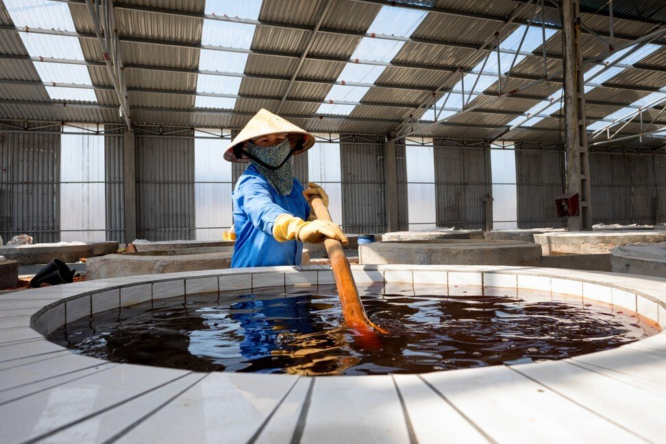 A worker stirs traditional fish sauce at a factory in Nghe An, Vietnam. Photo: Shutterstock