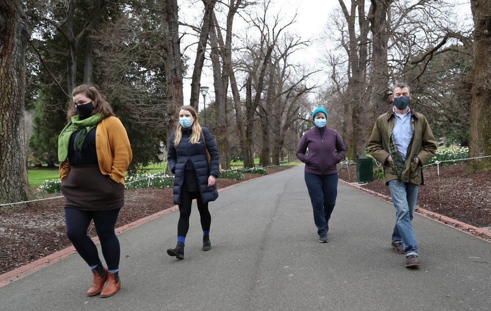 People in Melbourne wear face masks as they take a walk on July 18, 2020. Photo: EPA