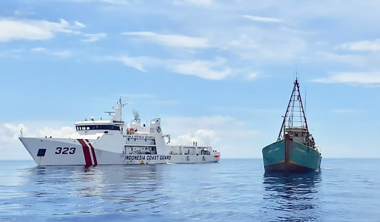 An Indonesian coastguard ship next to a Vietnamese fishing vessel. Photo: AFP