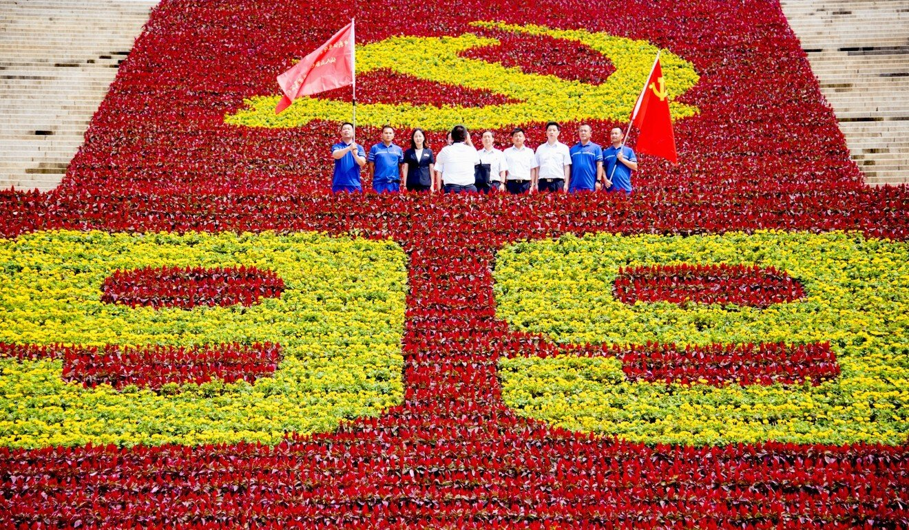 Communist Party of China members mark the 99th anniversary of the party's founding at the Yuhuatai Revolutionary Martyrs Cemetery in Nanjing city, China's Jiangsu province. Photo: Imaginechina