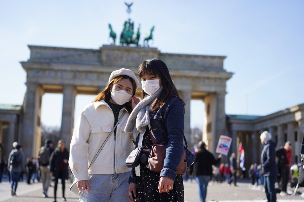 Tourists from Hong Kong stand in front of the Brandenburg Gate in Berlin. Southeast Asians who live in the city say they face racism all the time. Photo: Getty Images