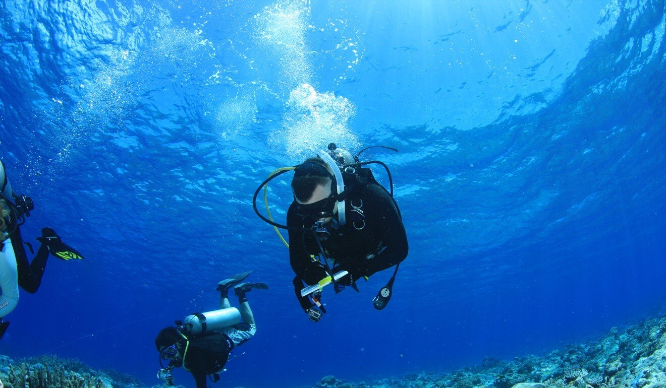 David Baker's job as a biologist is physically demanding and requires him to do field work like scuba diving. Photo: Handout
