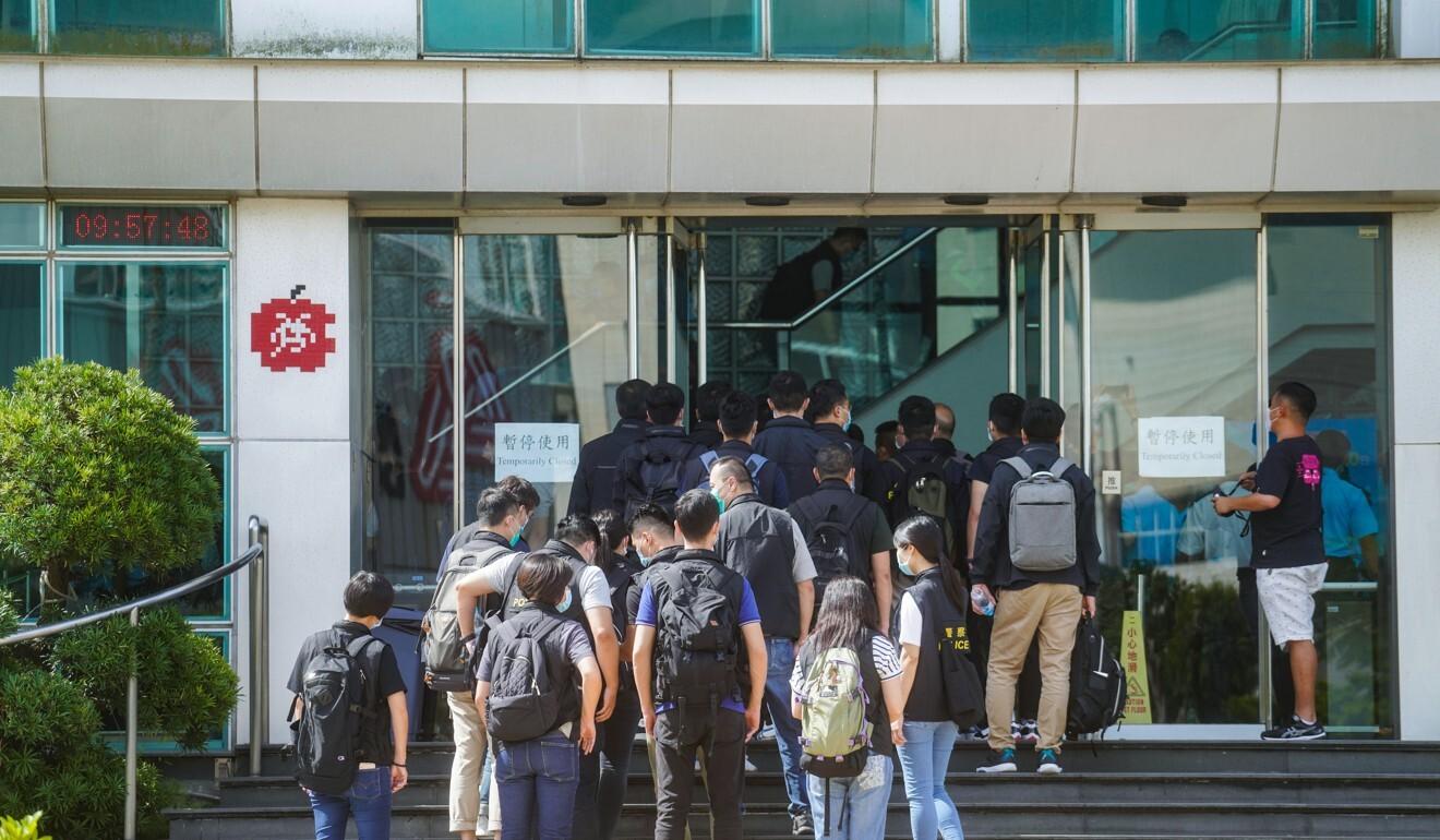 Police officers arrive at the Next Digital Limited building in Tseung Kwan O. Photo: Sam Tsang