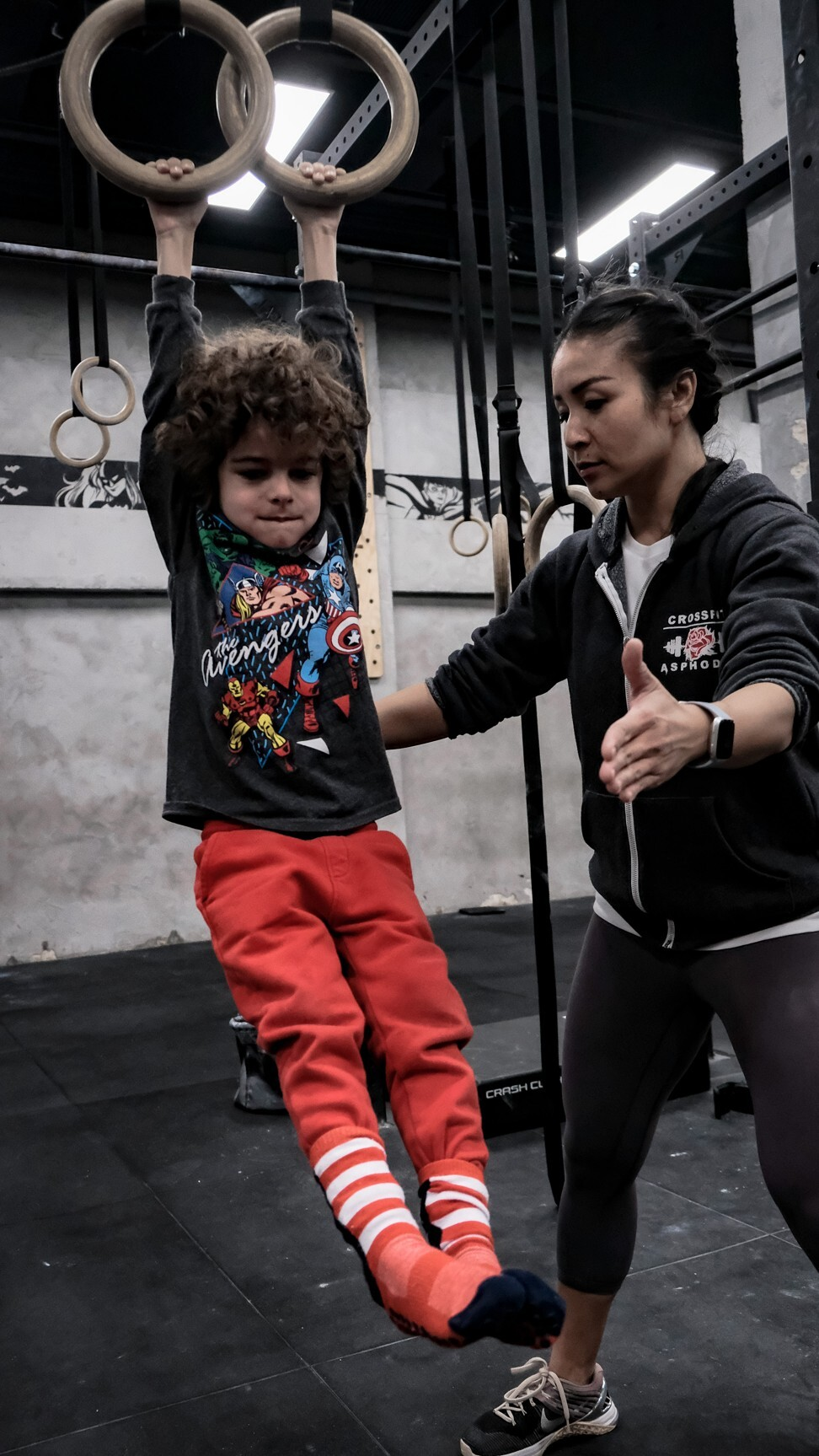 Michelle O'Brien helps a child on the rings. Photo: Handout