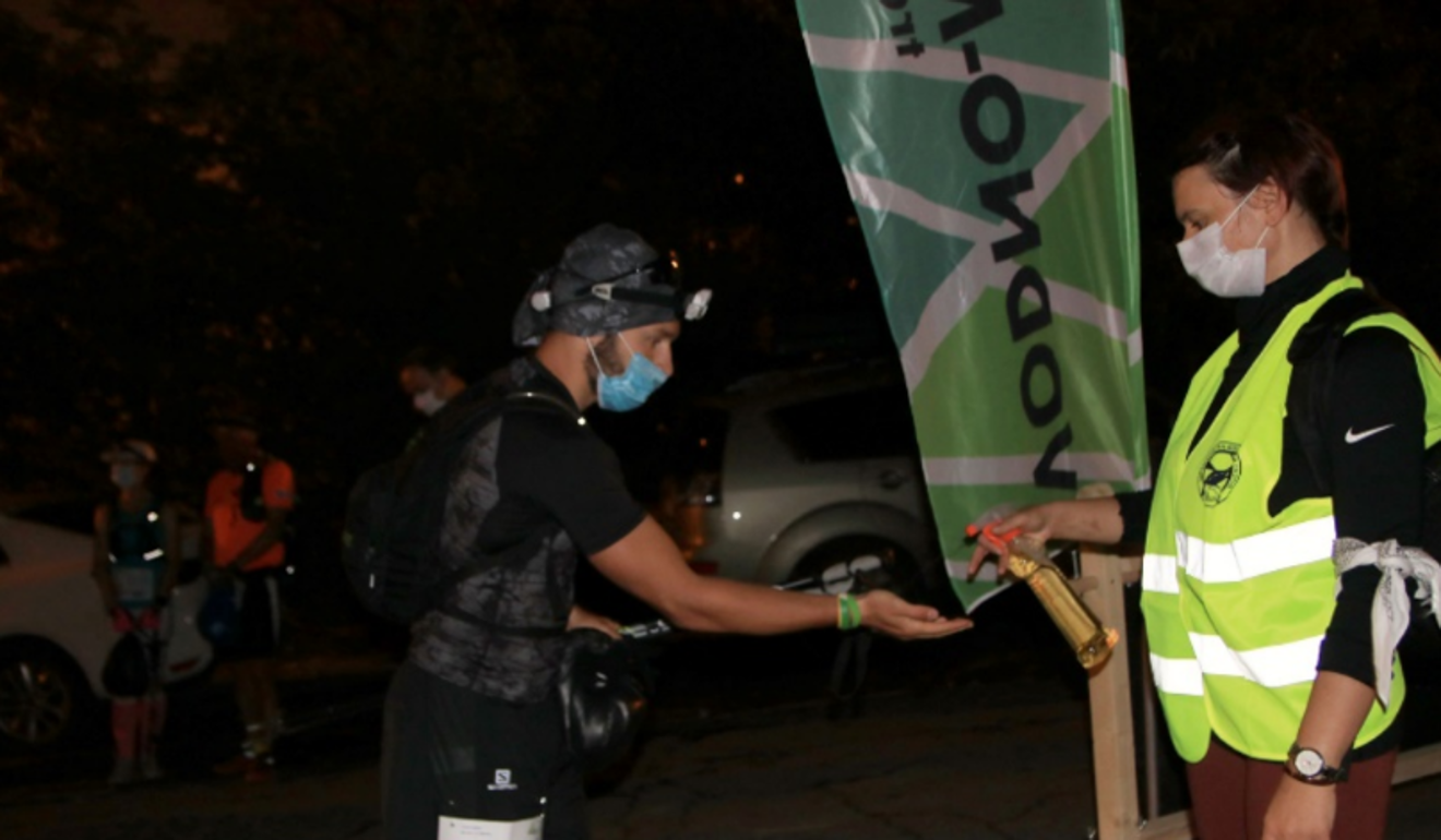 Hand sanitiser before entering a checkpoint helps protect runners and volunteers. Photo: ITRA