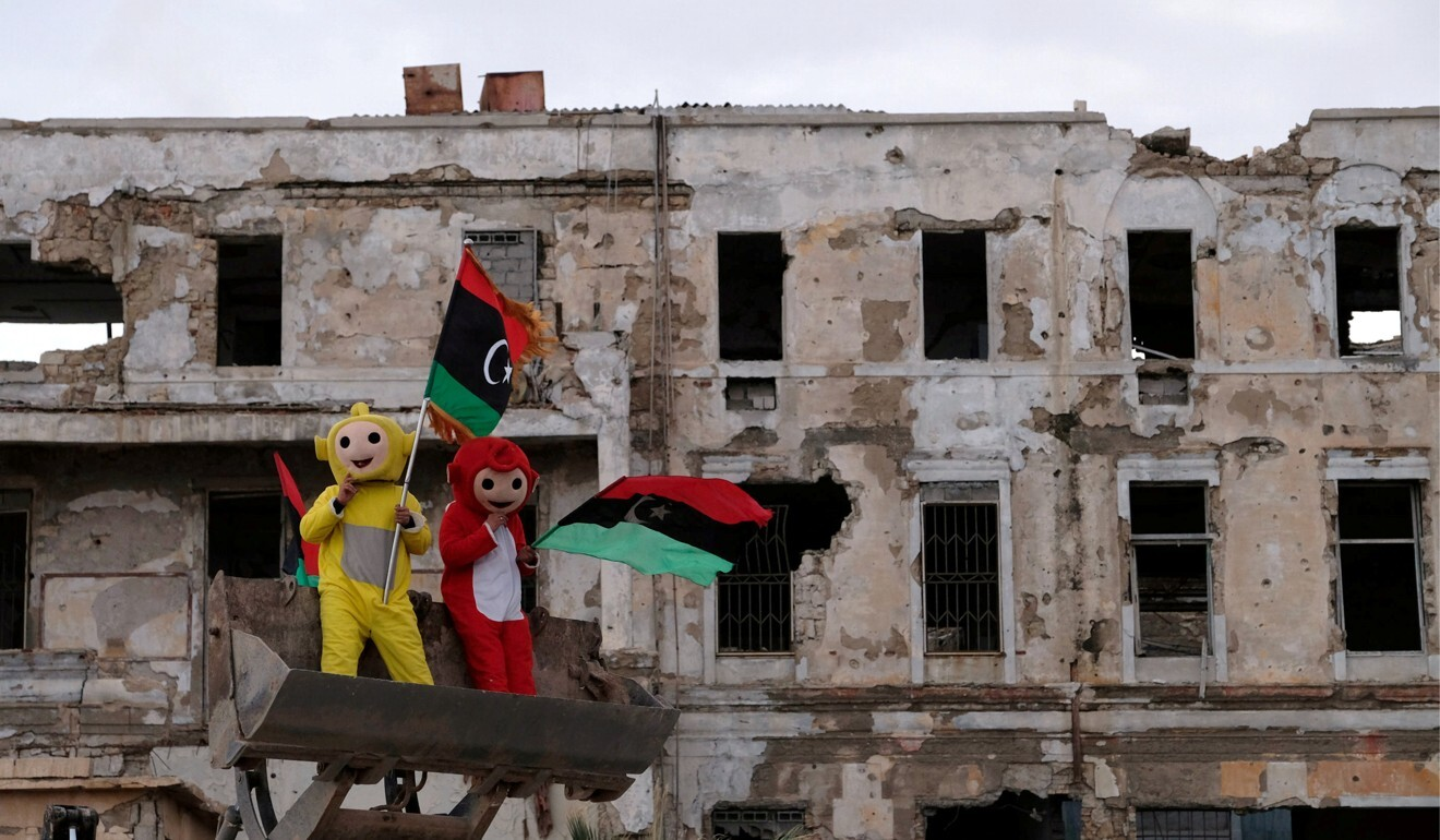Boys wear costumes and carry Libyan flags during a celebration of the eighth anniversary of the revolution in Benghazi, Libya on February 17, 2019. The oil-rich nation has been rocked by violent power struggles between an array of armed groups since the Nato-backed overthrow of dictator Muammar Gaddafi in 2011. Photo: Reuters