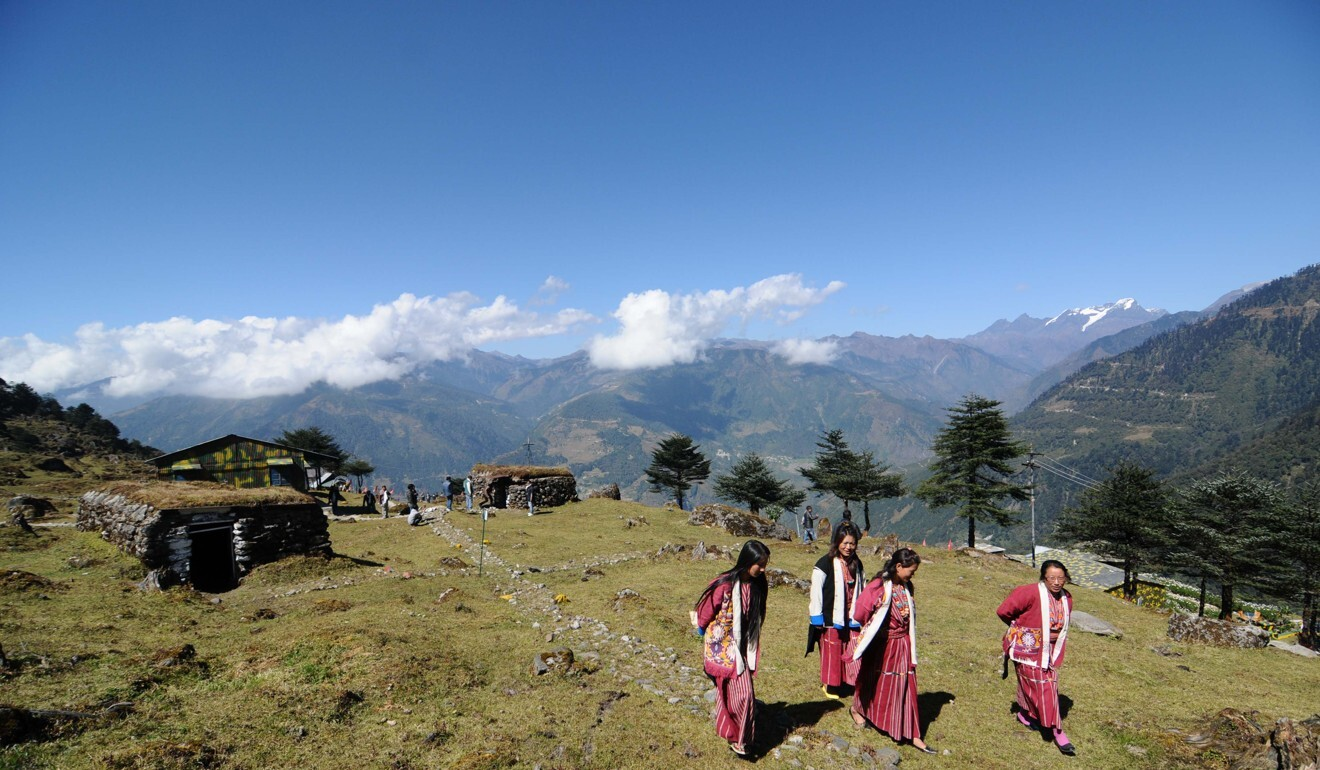 Tribal women visit bunkers from the Indo-China war at a memorial in Jaswant Garh in Arunachal Pradesh near the border. Photo: AFP