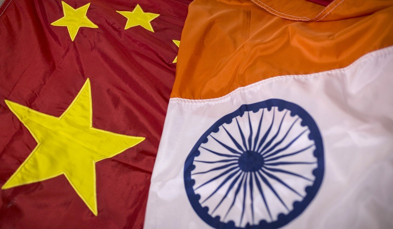 The Chinese and Indian flags. Photo: Bloomberg