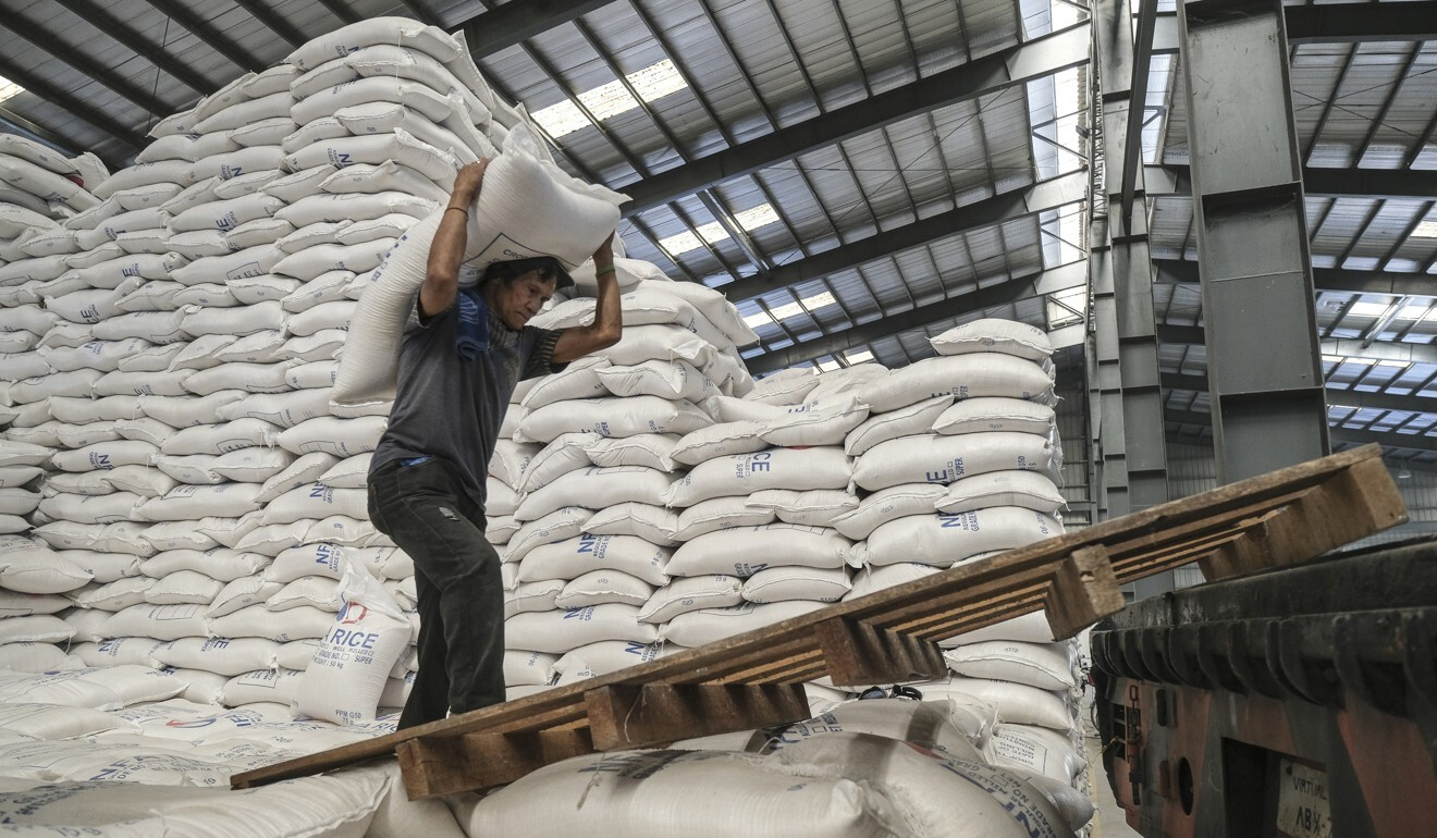 A worker carries a sack of rice in Valenzuela, Metro Manila, the Philippines. Photo: Bloomberg