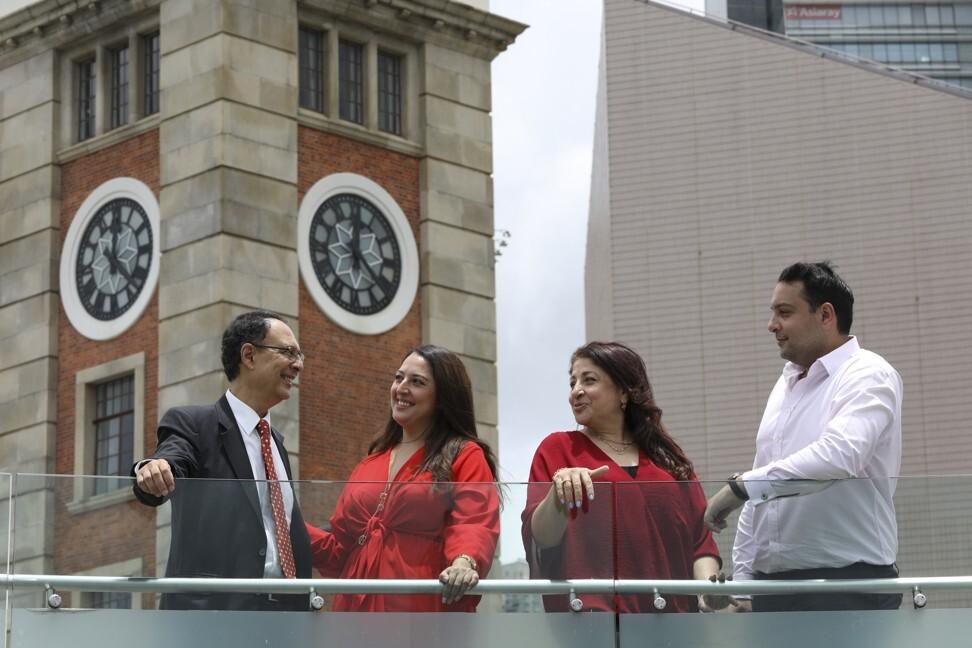 Neville Shroff, president of the Hong Kong Anjuman, with his wife Farida and their children Alisha and Nigel, at the Clock Tower in Tsim Sha Tsui. Photo: Antony Dickson