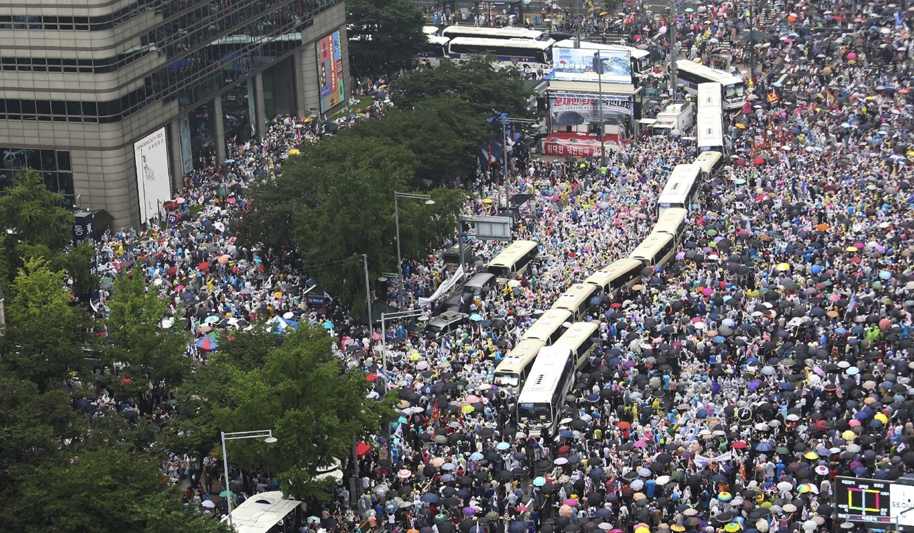 Protesters stage an anti-government rally in Seoul. Photo: AP