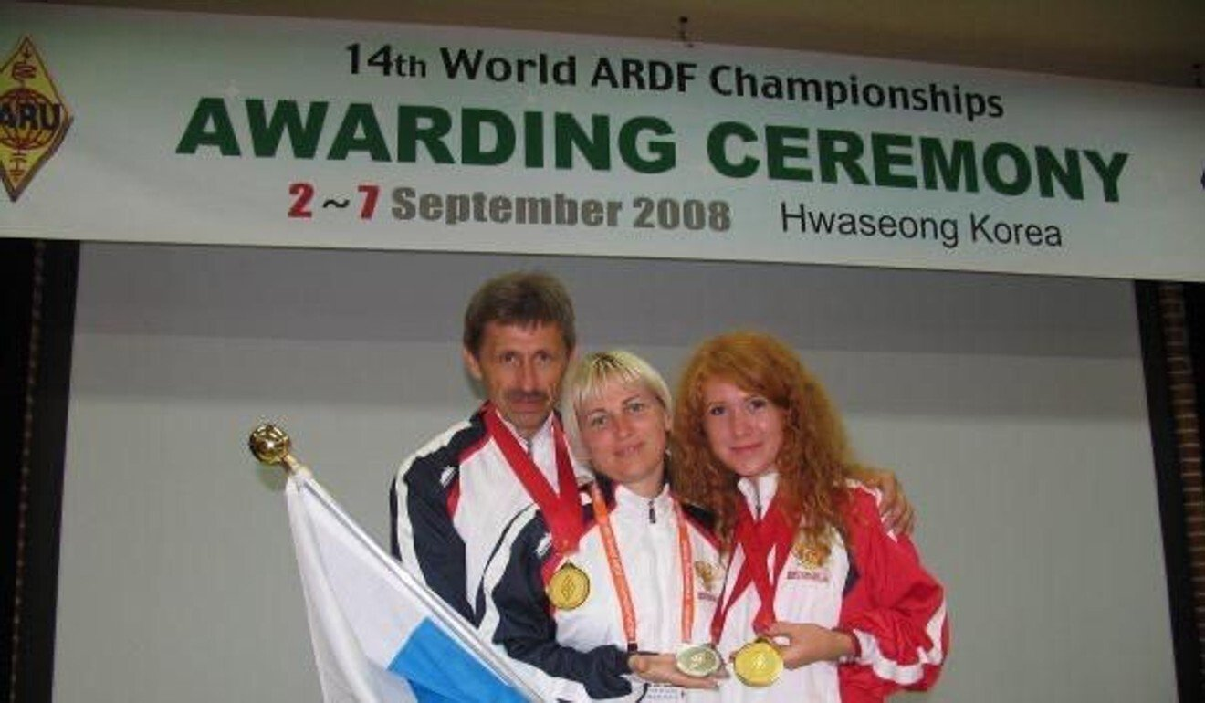 Ekaterina Mityaeva with fellow Russian team members and her gold medal at the 2009 Amateur Radio Detection Finding World Championships. Photo: Handout