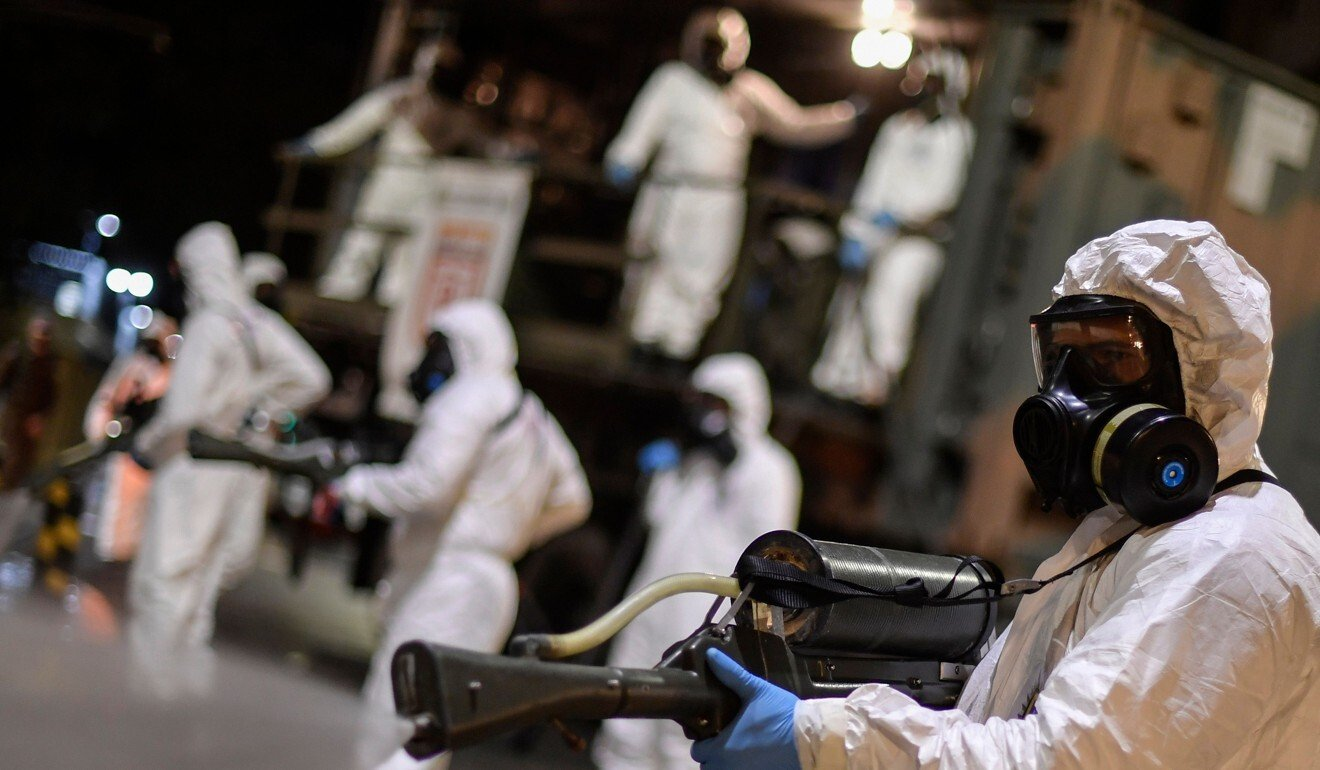 Soldiers from the 4th Military Region of the Brazilian Armed Forces take part in the cleaning and disinfection of the external area of the Municipal Market in the Belo Horizonte in Brazil. Photo: AFP