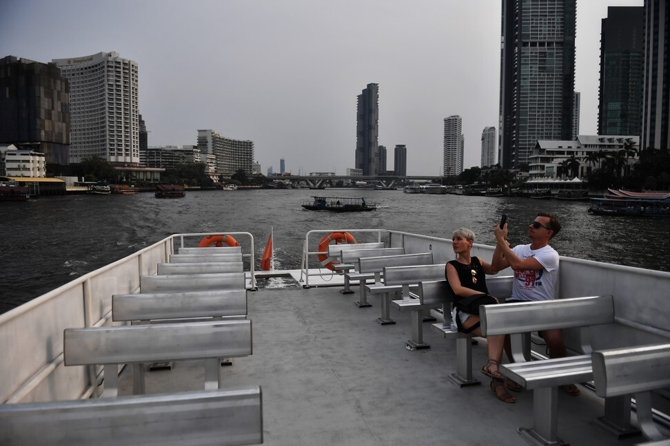 A lone couple take a tourist boat on the Chao Phraya River in Bangkok. Photo: AFP
