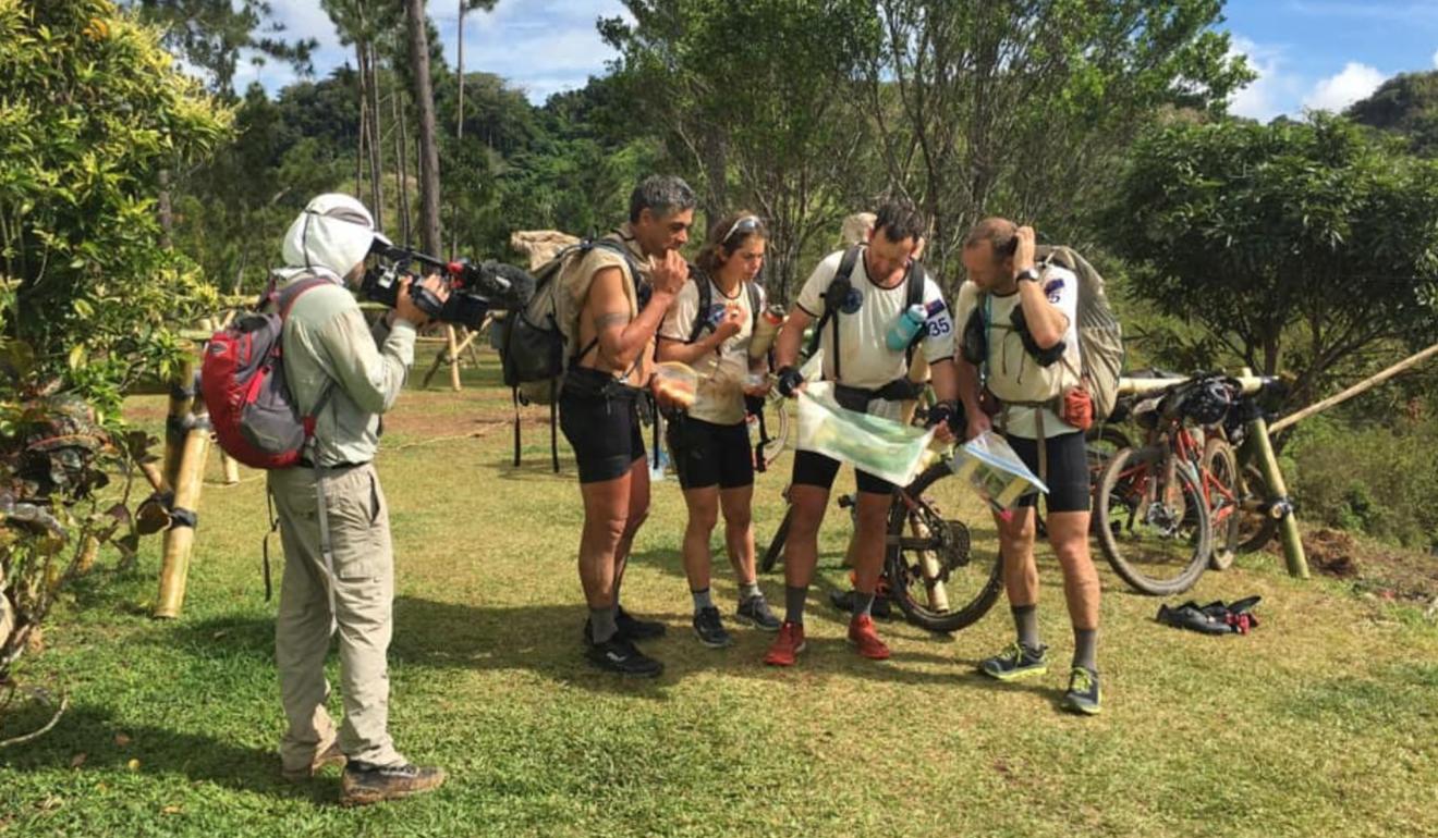 Team New Zealand study the map under the gaze of a camera. Photo: Handout