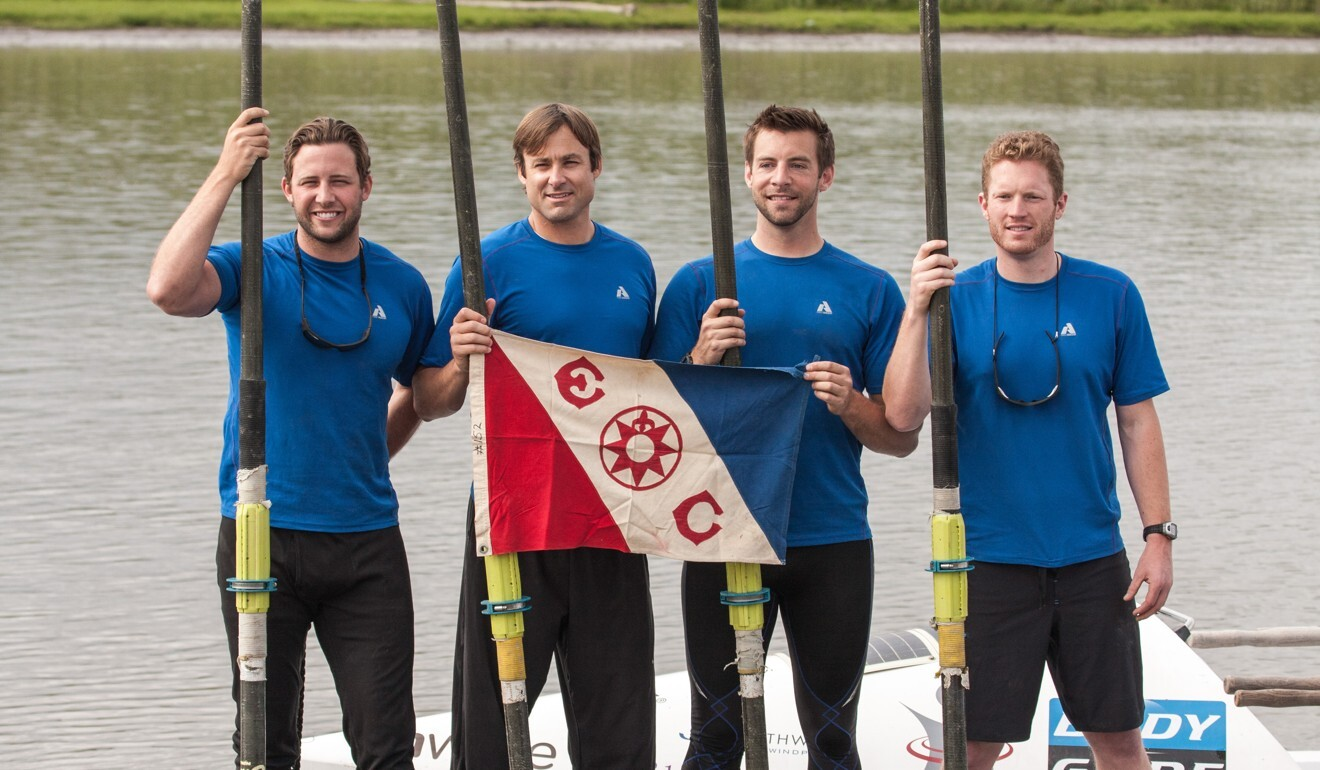 Paul Ridley (right), a Hong Kong-based American, and his team are the first people to row in the Arctic. Here they pose with the Explorers Club flag.
