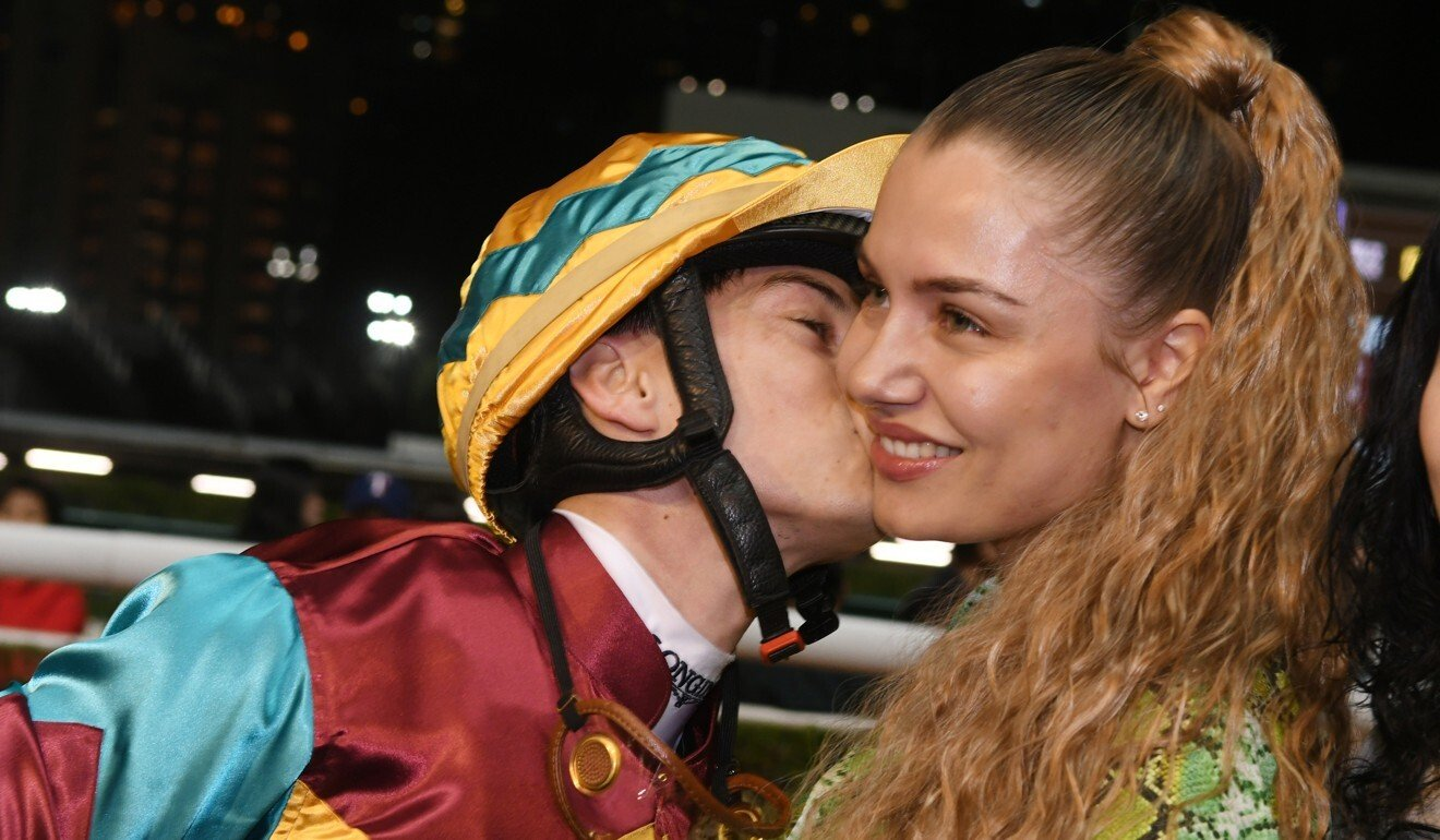 Jockey Alexis Badel kisses wife Eva after winning a race at Happy Valley.
