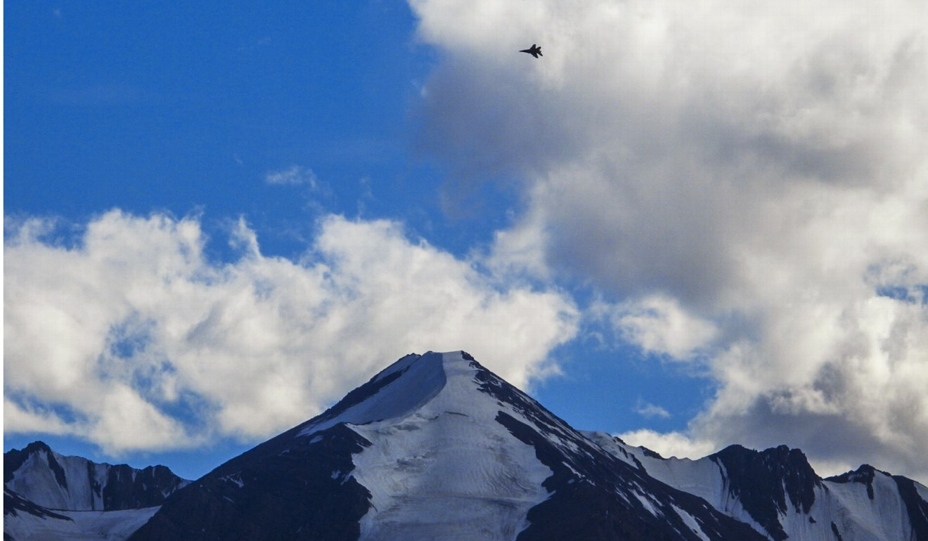 An Indian fighter jet flies over a mountain range in Leh, the joint capital of the union territory of Ladakh, on Monday. Photo: AFP