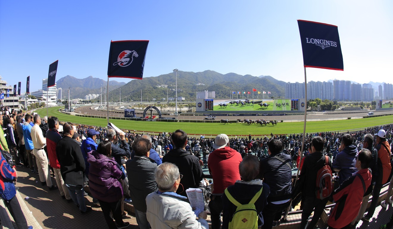 Fans watch horses compete at the 2019 Hong Kong International Races.