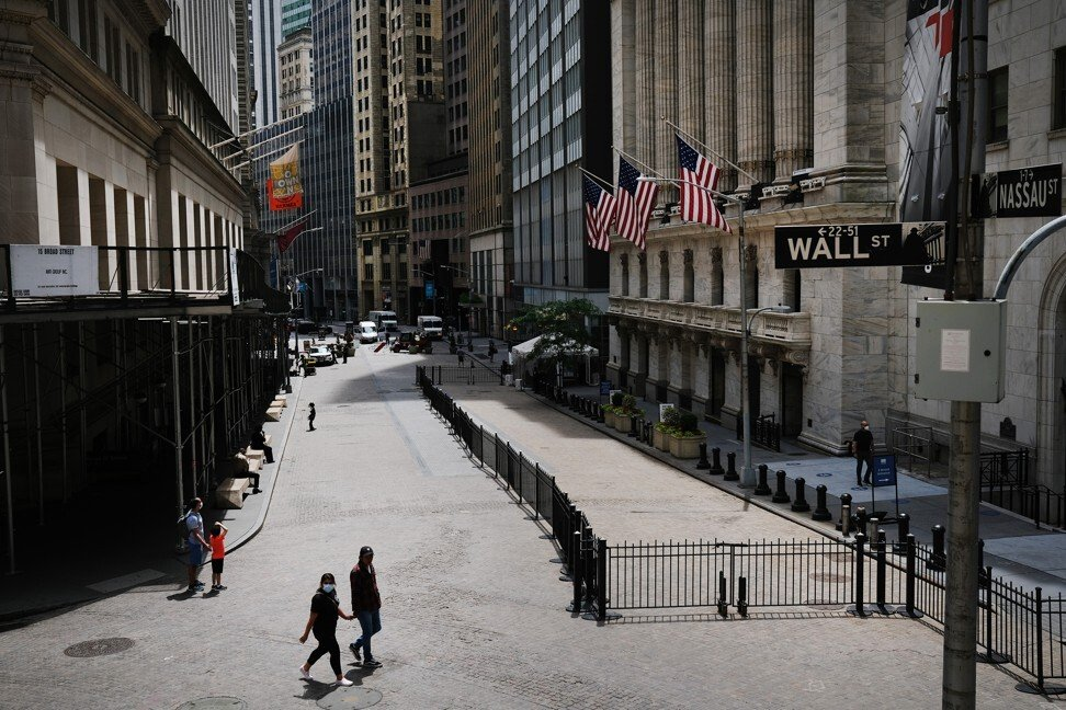 People walk by the New York Stock Exchange in an empty financial district on June 15 in New York City. Central bankers mistakenly think it is their job to defend the economy, flatten the cycle, eliminate boom and bust, prevent stock market crashes and support employment. Photo: Getty Images/TNS