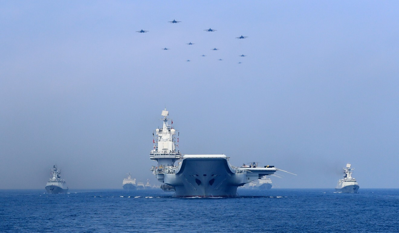 Warships and fighter jets of the Chinese People's Liberation Army Navy in the South China Sea. Photo: Reuters