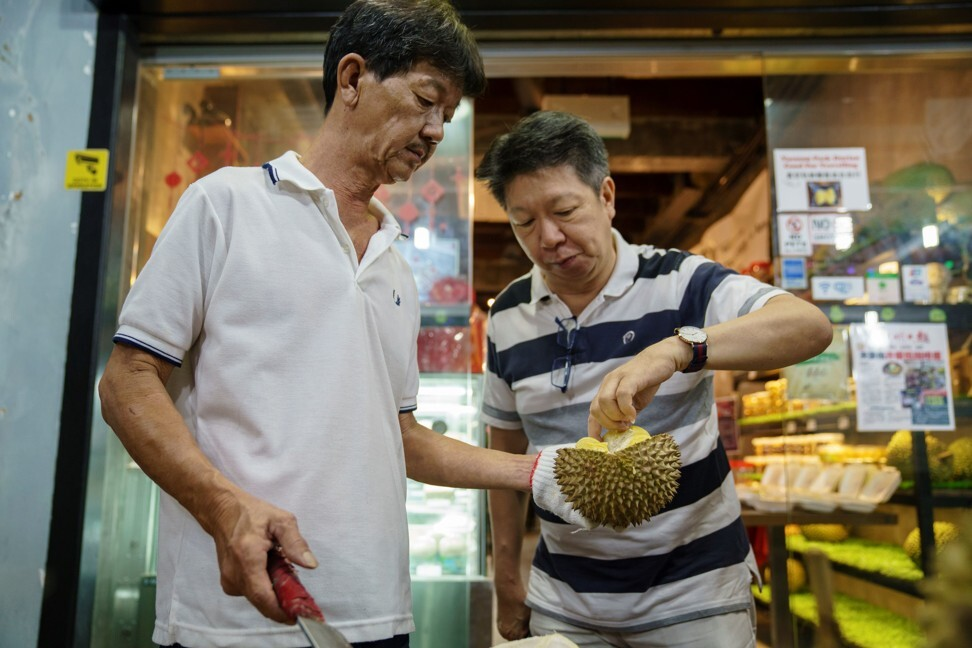 A customer samples durians at a durian store in Singapore. Photo: AFP