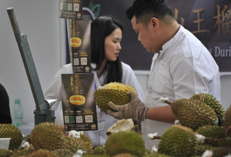 Workers sell Musang King durians at the Malaysia Durian Festival in Nanning, China, in November 2017. Photo: Reuters