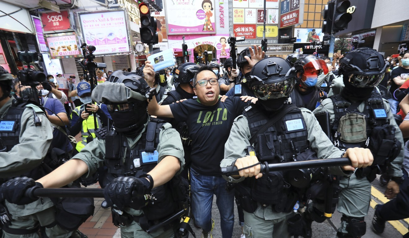 Activist Tam Tak-chi (centre), pictured during his May arrest at a national anthem law protest, was arrested again on Sunday over alleged seditious speech. Photo: May Tse