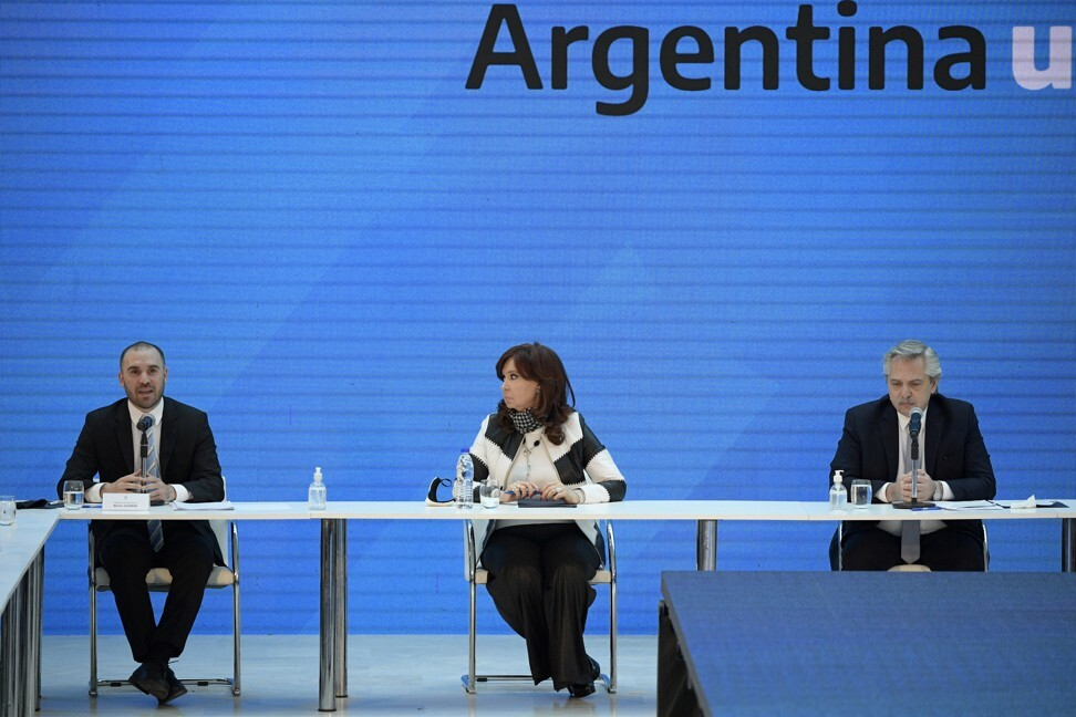 Argentina's President Alberto Fernandez (right), Vice-President Cristina Fernandez de Kirchner and Economy Minister Martin Guzman attend a news conference on restructuring Argentina's sovereign debt, in Buenos Aires on August 31. Argentina last month avoided a default after reaching agreement with creditors to restructure US$65 billion in sovereign debt. Photo: Reuters