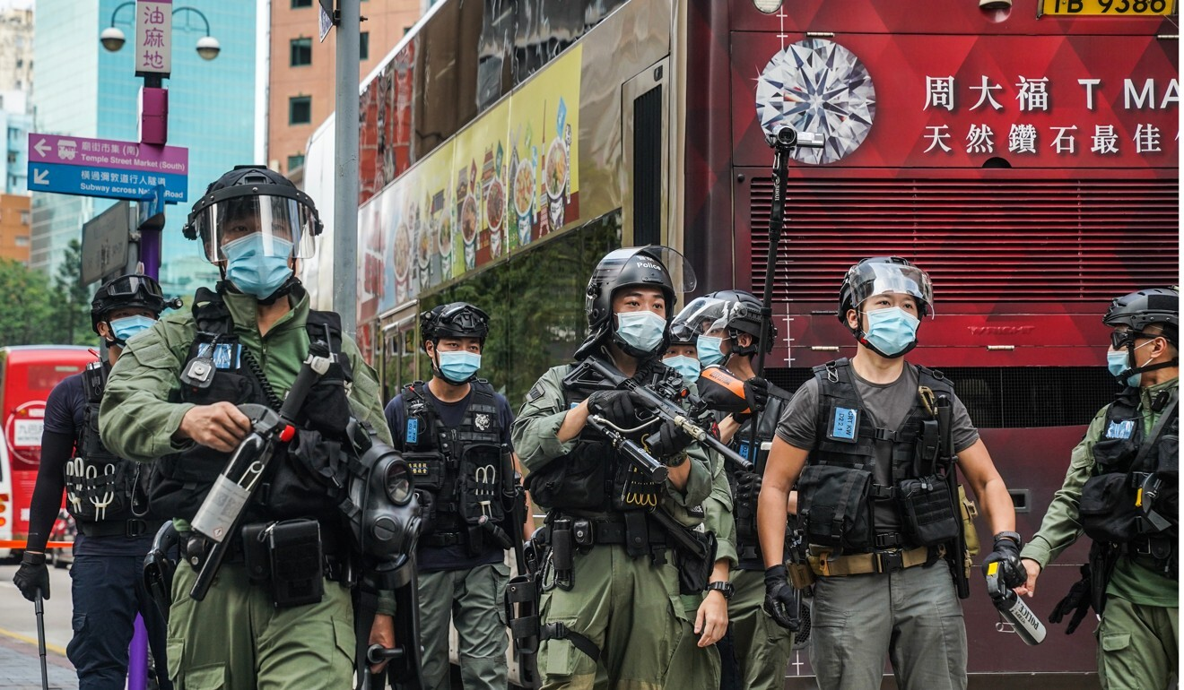 Riot police on the streets of Hong Kong. Photo: Bloomberg